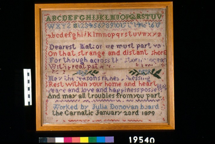Needlework sampler made by Julia Donovan on board Carnatic en route to Australia, 1879