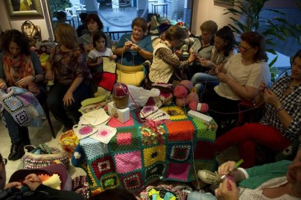 TO GO WITH AFP STORY BY DANIEL SILVA Women knit blankets for Syrian people, at
