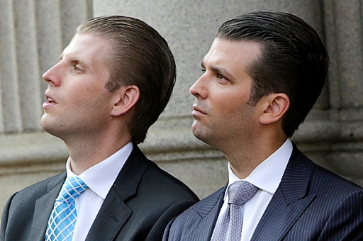 (L-R) Eric Trump, Donald Trump Jr., and Ivanka Trump attend the ground breaking of the Trump International Hotel at the Old Post Office Building in Washington July 23, 2014. The $200 million transformation of the Old Post Office Building into a Trump hotel is scheduled for completion in 2016. REUTERS/Gary Cameron (UNITED STATES - Tags: BUSINESS POLITICS REAL ESTATE) - RTR3ZUF0